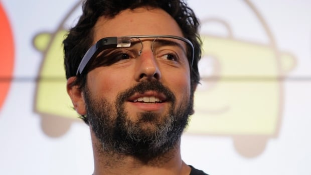 Google co-founder Sergey Brin wears Google Glasses while announcing the company's driverless plan initiative at a California news conference.