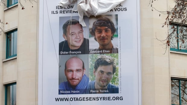 This poster calling for the release of Didier Francois, Edouard Elias, Nicolas Henin and Pierre Torres from captivity in Syria was hung in Paris in January. The four were found by Turkish forces on the Syria-Turkey border blindfolded and with their hands bound. They will return to France in the coming days.