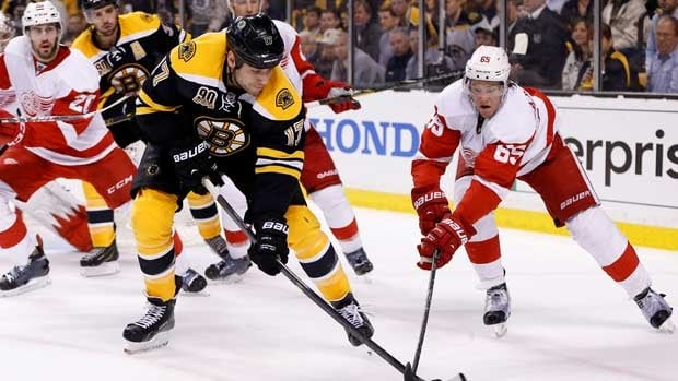 Boston's Milan Lucic, left, battles Danny DeKeyser of Detroit in a separate incident on Friday.