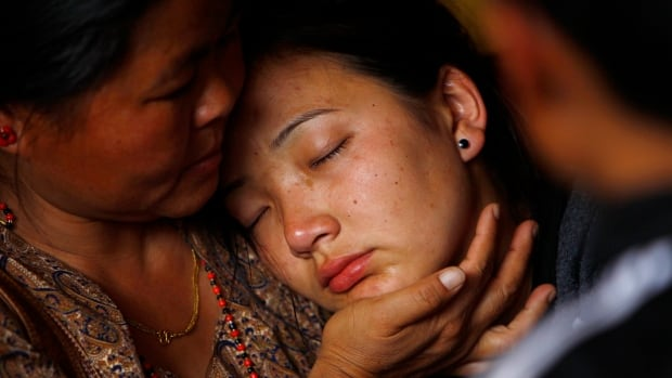 Daughter of Nepalese mountaineer Ang Kaji Sherpa, killed in an avalanche on Mount Everest, cries as her father's body is brought to the Sherpa Monastery in Katmandu, Nepal, Saturday.