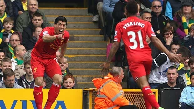 Liverpool's Luis Suarez, left, celebrates scoring his side's second goal with Raheem Sterling who scored their first, during their English Premier League match at Carrow Road, Norwich.