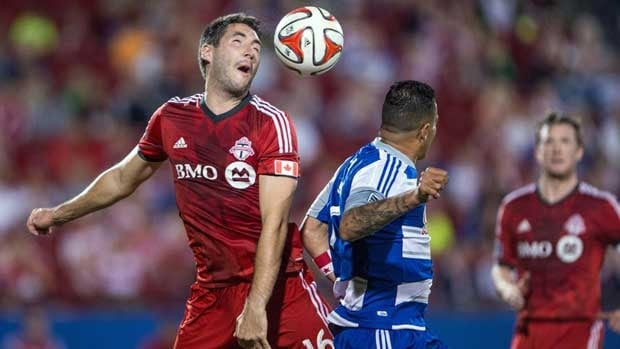 Toronto FC defender Bradley Orr and FC Dallas forward Blas Perez fight for the ball during the second half at Toyota Stadium on Saturday.