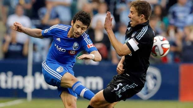 Sporting KC defender Matt Besler blocks a kick by Montreal Impact midfielder Felipe Martins, left, during the first half on Saturday.