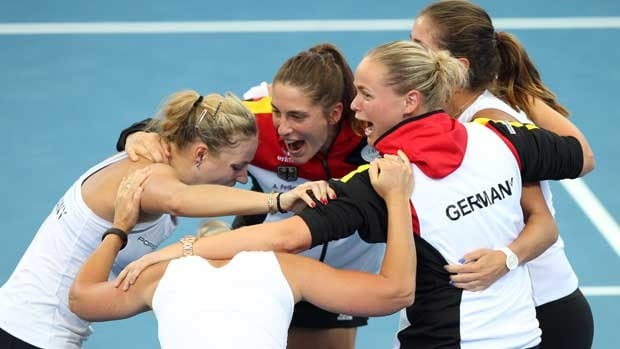 German team members Andrea Petkovic, Julia Georges, Anna-Lena Groenfeld, team captain Barbara Rittner and Angelique Kerber celebrate after defeating Australia 3-0 in Brisbane.