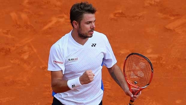 Swiss player Stan Wawrinka celebrates a point Sunday against friend and frequent Davis Cup partner, Roger Federer.
