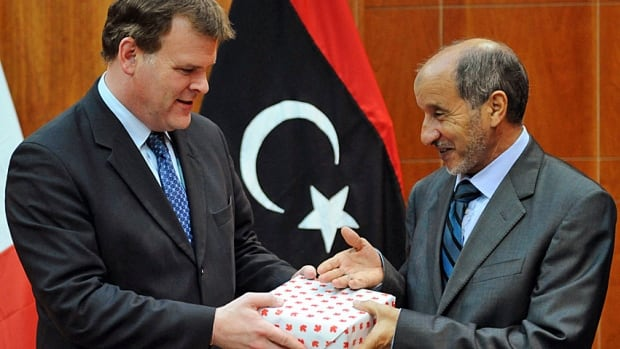 Foreign Minister John Baird, left, offers a gift to Mustafa Abdel Jalil, chairman of Libya's National Transitional Council, in Tripoli in late 2011. Ministers and other senior government officials who exchange gifts with foreign dignitaries have their own official store of Canadian items to draw on.