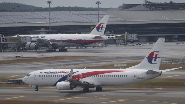 A Malaysia Airlines Boeing 737-800 plane taxis by the main terminal at Kuala Lumpur International Airport. A similar B737-800 aircraft operated by the airline made an emergency landing early Monday morning after a landing gear malfunction.