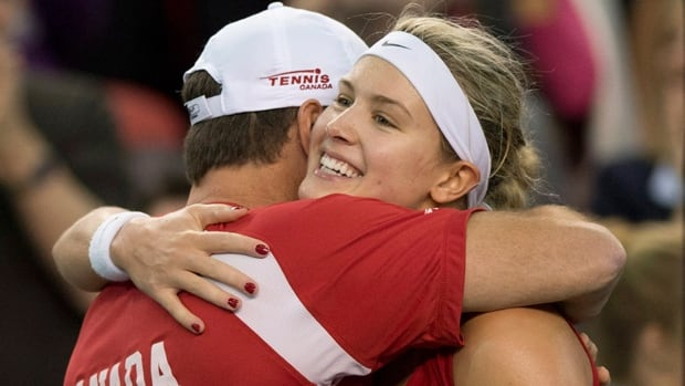 Eugenie Bouchard is embraced by Team Canada coach Sylvain Bruneau after a 7-6, 6-3  victory over Jana Cepelova on Sunday.