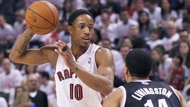 DeMar DeRozan (10) of the Raptors looks to pass on Shaun Livingston of the Nets in Game 1 at Air Canada Centre on Saturday.