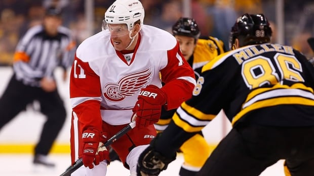 The Red Wings' Daniel Alfredsson, left, will miss Tuesday night's game against Kevan Miller, right, and the Bruins with an upper-body injury. Alfredsson, 41, played 17 minutes three seconds in a 4-1 loss Sunday in Game 2 of the first-round series.