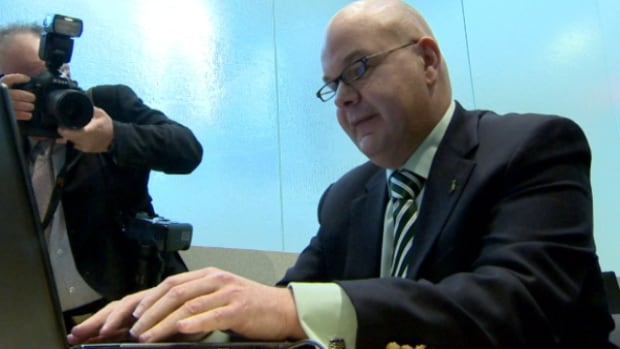 Health Minister Fred Horne tries out the new online registry at a news conference on Tuesday.