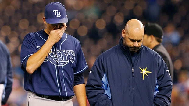 Tampa Bay Rays starting pitcher Matt Moore, left, walks off the field with a trainer following an injury during a game against the Kansas City Royals on April 7.