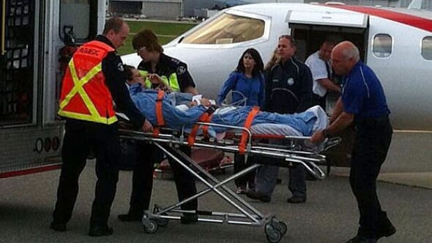 Kenzie Markey lands at Vancouver airport and is transferred to an ambulance following a three hour flight from Arizona.