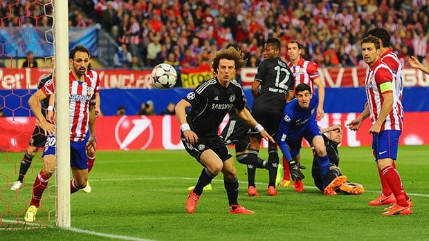 Chelsea's David Luiz, in black, and Thibaut Courtois of Atletico Madrid watch the ball go wide of the goal during their UEFA Champions League semifinal match on Tuesday.