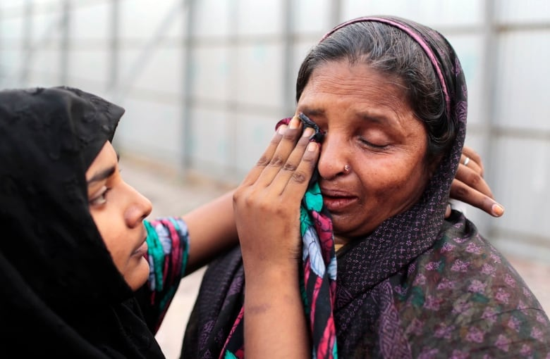Bangladesh's Rana Plaza factory collapse spurs change, finger-pointing