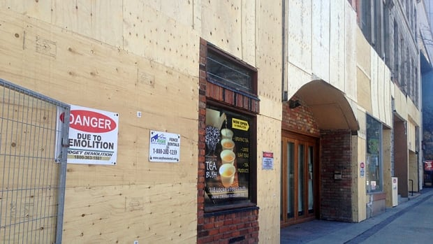 The Hughson Business Space Corporation has cleaned up the buildings at 18-28 King St. E. to comply with city property standards.
