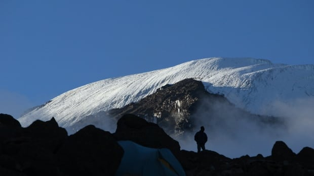 The summit of Tanzania's Mount Kilimanjaro is seen in this 2006 photo taken from the Barafu Hut camp, the last resting point for most climbers before attempting to reach the summit. Some 20,000 tourists attempt to climb the 5,895-metre summit every year.