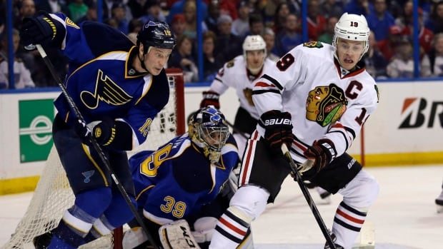 Chicago Blackhawks captain Jonathan Toews, right, and former Team Canada teammate Jay Bouwmeester of St. Louis battle earlier in the series.