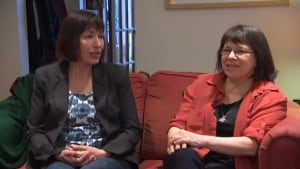 Natasha Griffiths (left, Susan Griffiths' daughter) reminisces with friend Cindy Rublee (right)