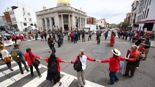 Cowboy and Indian Alliance protest against Keystone XL pipeline spills into streets in Washington, D.C.