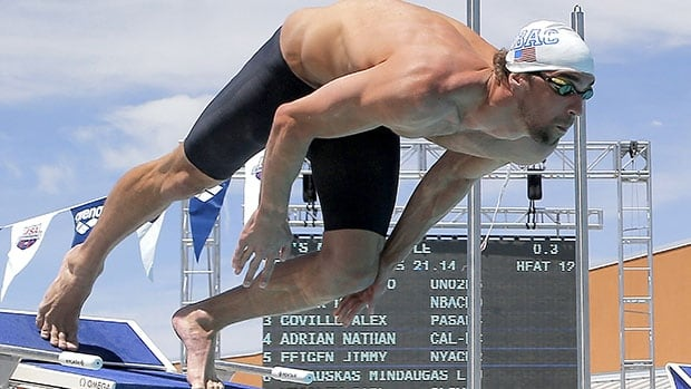 Michael Phelps starts his 50-metre freestyle preliminary heat at the Arena Grand Prix event in Mesa, Ariz.