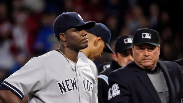 Home plate umpire Gerry Davis ejects New York Yankees starting pitcher Michael Pineda after a foreign substance was discovered on his neck on Wednesday.