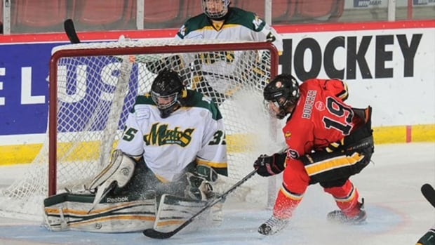 Lane Michasiw makes a save as the Prince Albert Mintos earn first place in the preliminary round of the Telus Cup, underway in Moose Jaw.