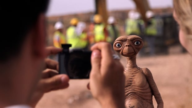 The successful 1982 film E.T. the Extraterrestrial, about a friendly alien's struggle to leave Earth and return to his space home, spun popular toys like this E.T. doll. But the Atari game E.T. the Extraterrestrial flopped. On Saturday, documentary producers unearthed millions of cartridges of the game that were buried in a New Mexico landfill in 1983.