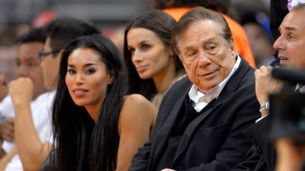 Los Angeles Clippers owner Donald Sterling, right, and V. Stiviano, left, are shown watching the Clippers play the Sacramento Kings early this season.