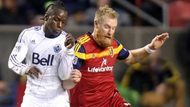 Vancouver Whitecaps player Darren Mattocks, left, and Real Salt Lake's Nat Borchers go for the ball on Saturday in Sandy, Utah.