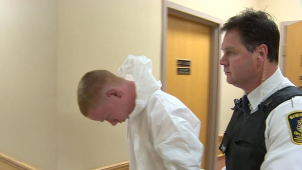 Brandon Tobin, 20, is escorted back to jail after a brief appearance in provincial court Sunday morning.
