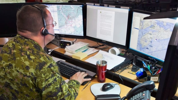 Search and rescue personnel at the Joint Rescue Coordination Centre in Halifax. The operation handles 2,700 search and rescue cases a year and cover 29,000 km of coastline.