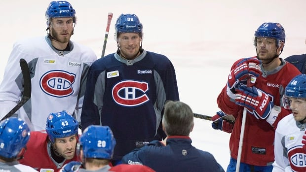 Players from the Montreal Canadiens listen to assistant coach Jean-Jacques Daigneault during a practice session in Brossard, Que., on April 25.