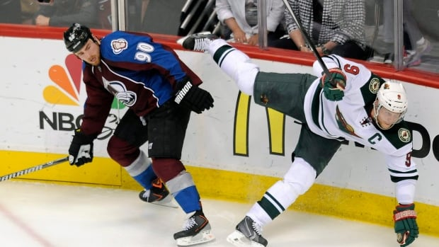 Colorado Avalanche centre Ryan O'Reilly, left, and Minnesota Wild centre Mikko Koivu, collide in overtime in Game 5.