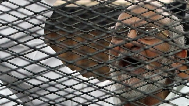 An Egyptian court has recommended the death sentence for the leader of the Muslim Brotherhood, Mohamed Badie, pictured in the defendant's cage during his trial in a Cairo courtroom in 2013.
