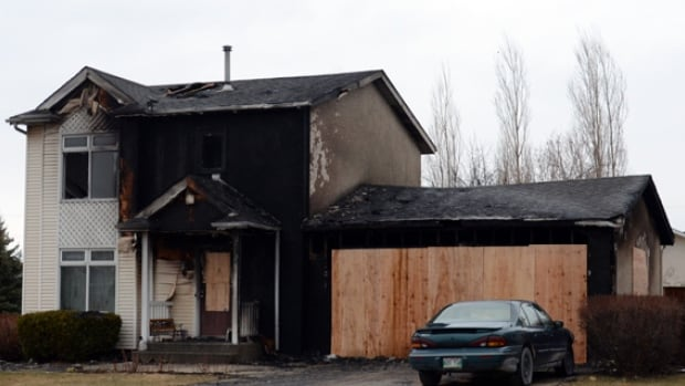 The fire in the Steinbach, Man., home at 1 Cypress Place began in the garage, later spreading to the two-story home (photos and video courtesy of Steinbach Online).