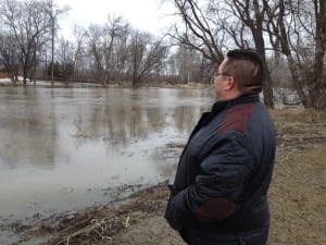 Chief of Peguis First Nation Glenn Hudson looking at Fisher River