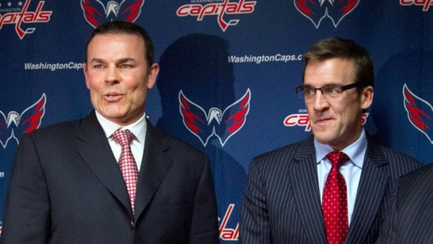 "Ex-Capitals GM George McPhee, right, wasn't in the mood to discuss his working relationship with the team's former head coach, Adam Oates, left, on Monday. But he did say he ""loved working with"" Oates's immediate predecessors Bruce Boudreau and Dale Hunter."