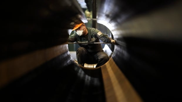 An employee works on pipes made for the South Stream pipeline in Vyksa, east of Moscow on April 15. Russia's energy ministry said on Monday that a tentative agreement has been reached for three-way talks between Russia, Ukraine and the EU on Ukraine's gas debt to Moscow, to be held later this week.