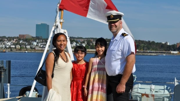 Lt. Derek de Jong, right, was charged with desertion after leaving HMCS Preserver in September 2012, while it was docked in Florida. His wife, Maria de Jong, left, says her husband was harassed while on board the ship.