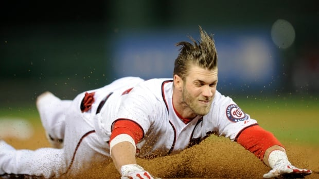 Washington Nationals left-fielder Bryce Harper slides into third on April 25, injuring his thumb in the process.
