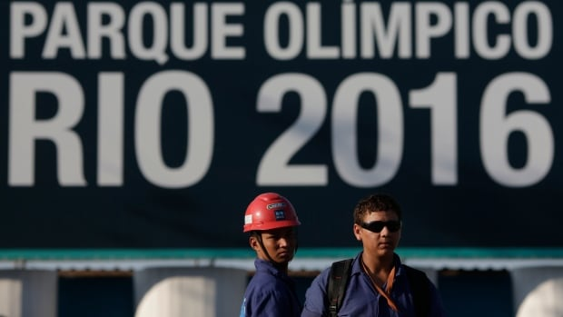 Construction workers on strike stand outside the Rio 2016 Olympic Park construction site in Rio de Janeiro. An IOC official says the Brazilians are behind 'in many, many ways' and are in worse shape than Greek organizers were in preparing for the 2004 Olympics.