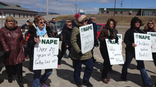 A group of protesters gathered outside MHA Joan Shea's office in Stephenville on Tuesday to oppose the privatization of a youth home in the community.