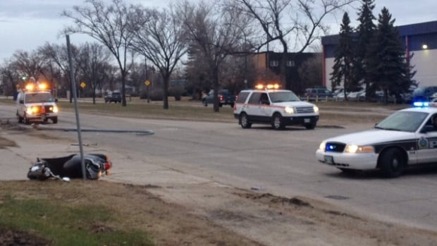 A motorcycle lies on the ground after a crash near Inkster Boulevard and Fife Street on Wednesday morning in Winnipeg.