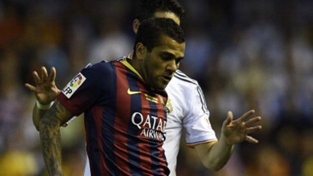 Spanish police arrested the man who racially insulted Barcelona defender Dani Alves, front, by throwing a banana at him, with reports on Wednesday claiming the perpetrator worked for Villarreal.