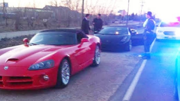 RCMP stop a red Viper and black Lamborghini on Main Street Tuesday evening.