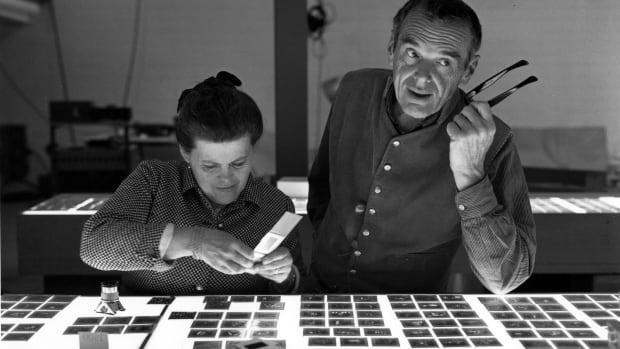 Ray and Charles Eames selecting slides for the exhibition, Photography & the City, 1968, as seen in Jason Cohn and Bill Jersey's documentary EAMES: The Architect and the Painter.
