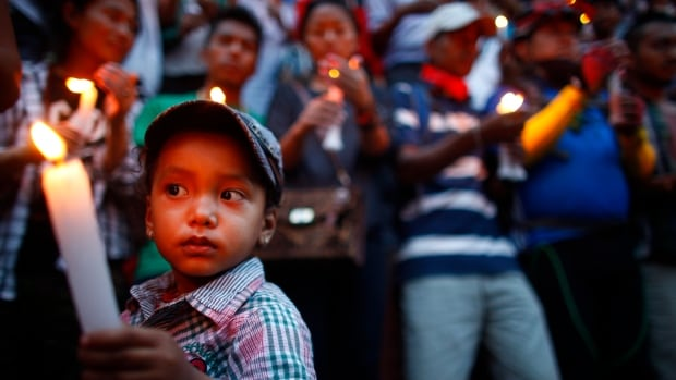 People gather for a memorial service in Katmandu, Nepal, commemorating the 16 Nepalese Sherpa guides killed in an avalanche on Mount Everest on April 18 avalanche was the deadliest disaster on the world's highest mountain.