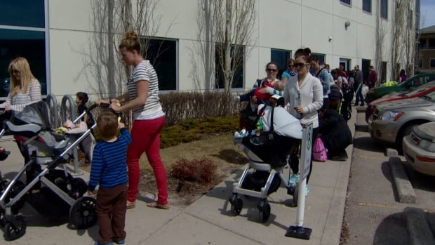 People line up around the South Calgary Health Centre at one of the measles vaccination clinics underway in Calgary.