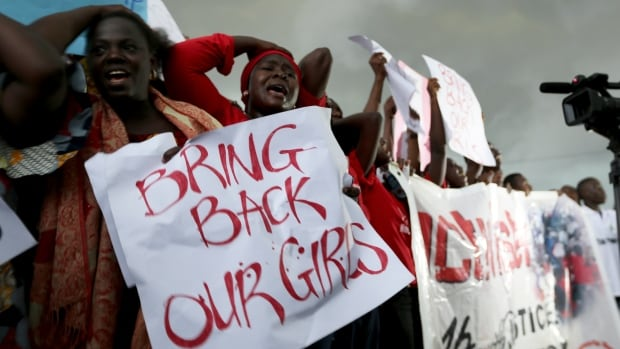 Protesters gather outside Nigeria's parliament in Abuja on Wednesday, demanding security forces to search harder for 200 schoolgirls abducted by Islamist militants two weeks ago. A local civic group is reporting that the girls are being forced to marry their abductors.